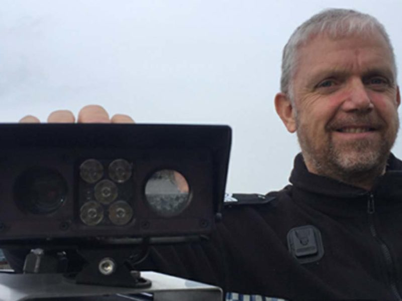 An officer with one of the ANPR cameras