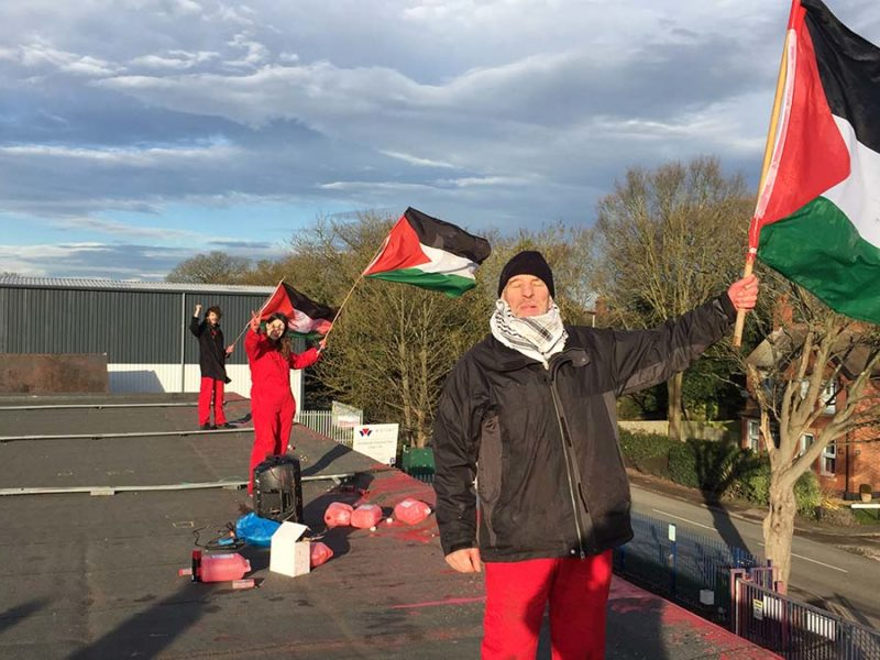 Palestine Action members on the roof of the factory in Shenstone. Picture: Vladimir Morozov