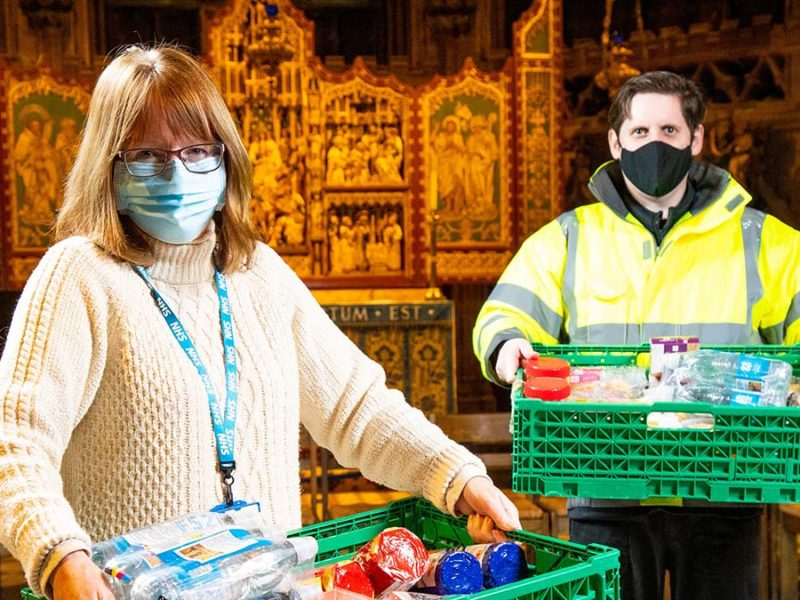 Richard Hinsley hands over the donations to Kirsty Burton at Lichfield Cathedral