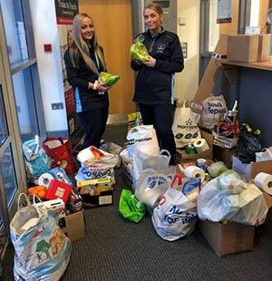 Alisha Vivian and Vikki Wilson with some of the items previously donated to the foodbank