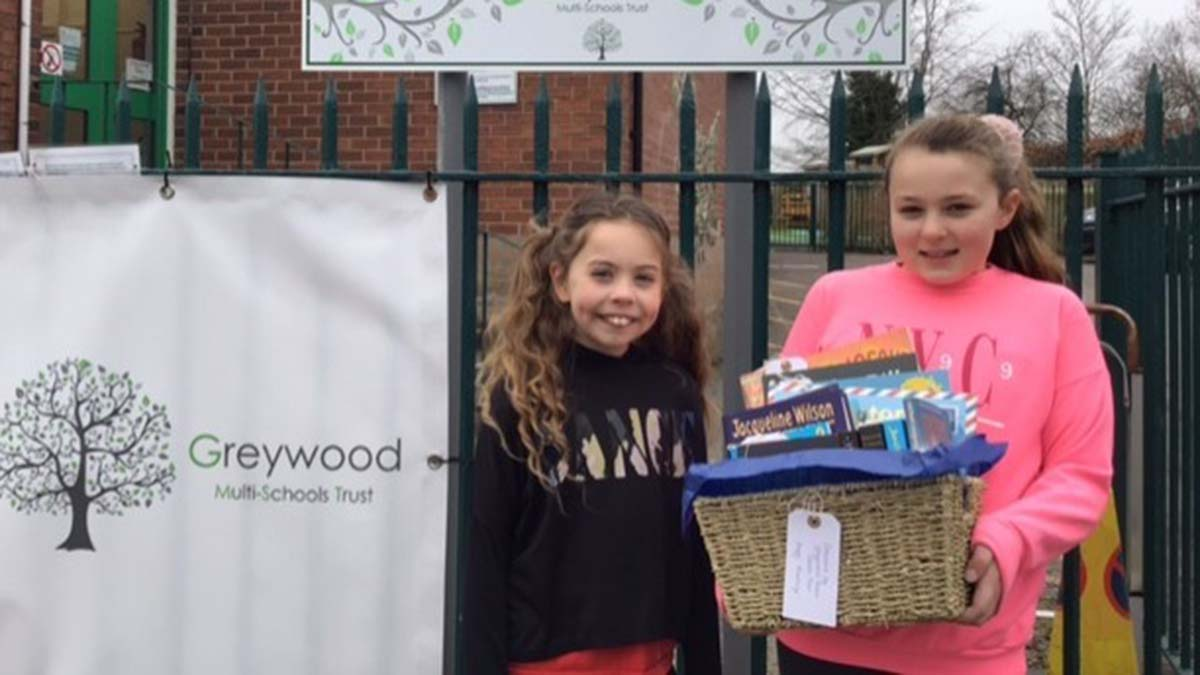 Piper Quinn and Isabelle Delaney from Henry Chadwick Primary School with one of the book hampers