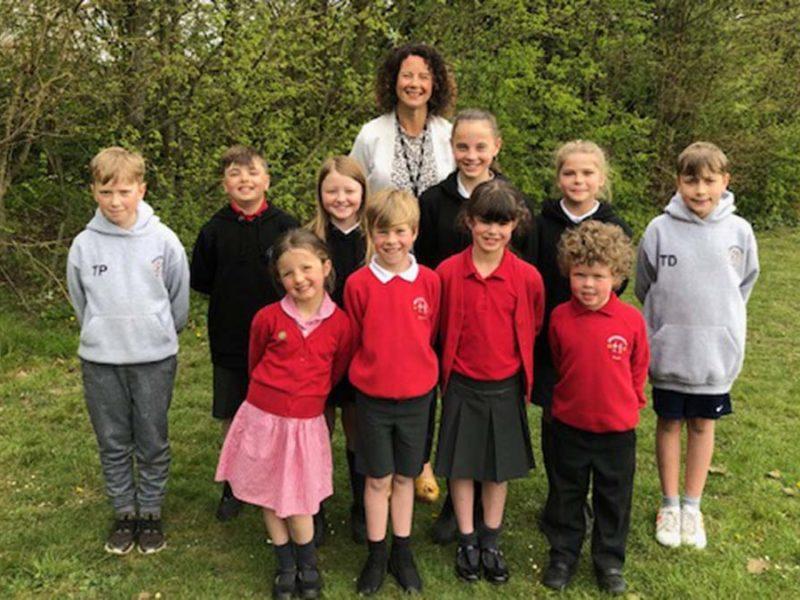 Headteacher Ellie Ballinger with pupils from Greysbrooke Primary School
