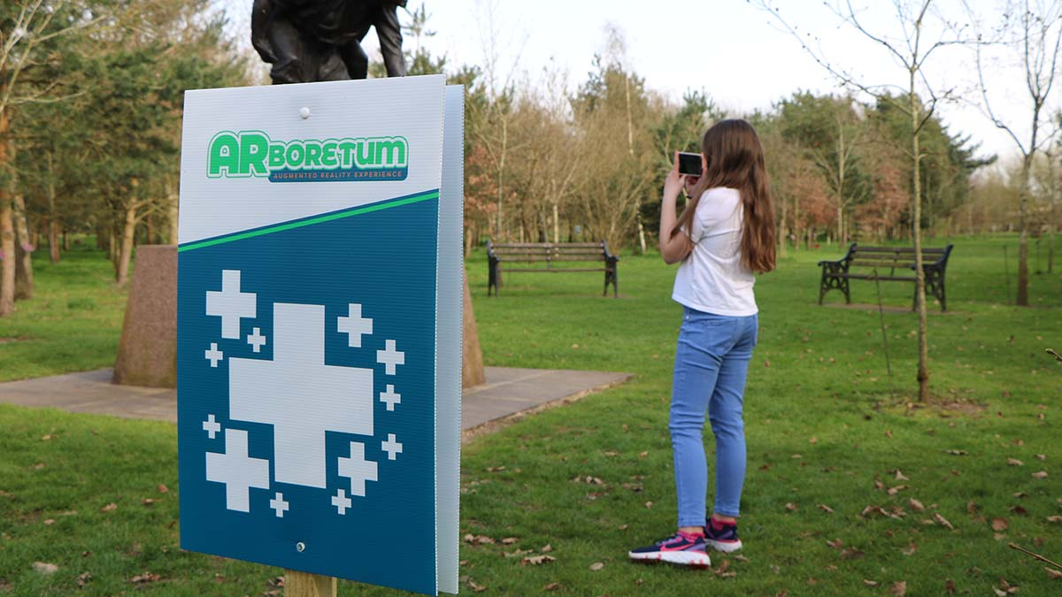 A visitor using the app at the National Memorial Arboretum
