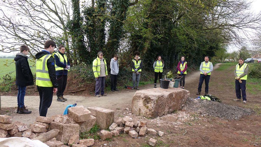 Duke of Edinburgh volunteers holding a minute's silence alongside the Lichfield Canal