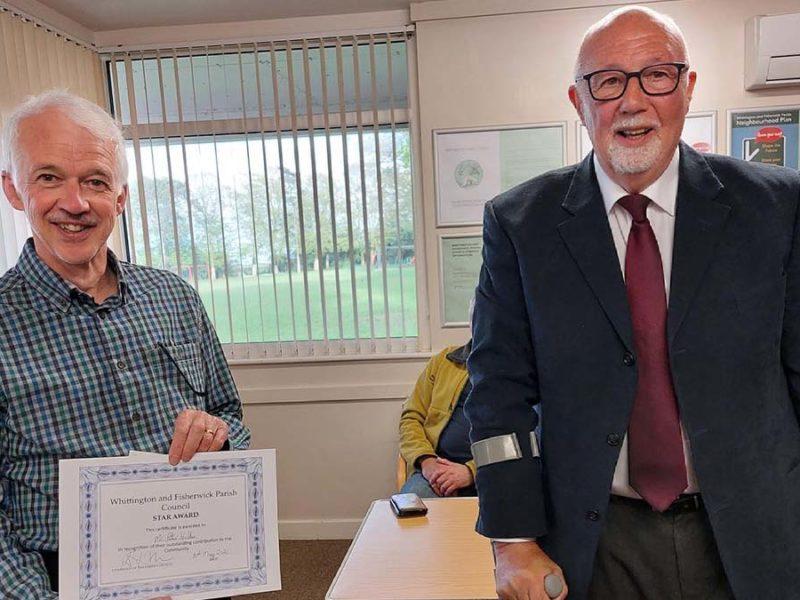 Peter Hollis receiving his award from Cllr Garry Hyde