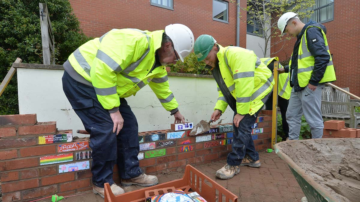 Work taking place on the memorial wall