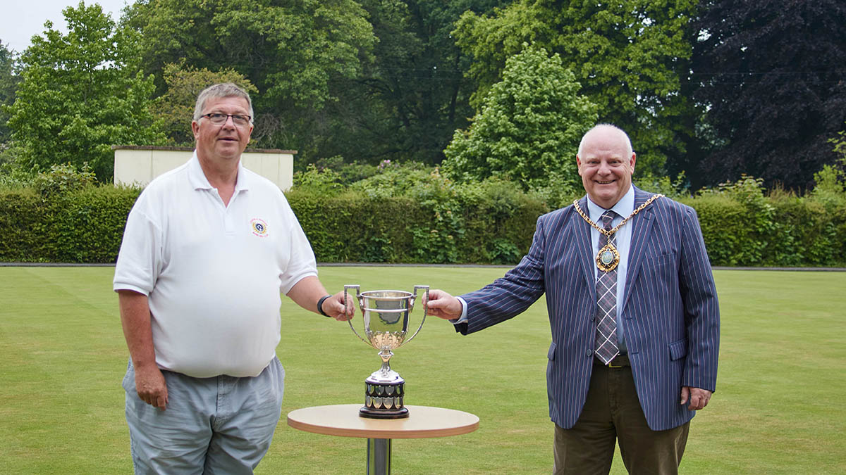 Andy Hayes being presented with the trophy by Cllr Robert Yardley