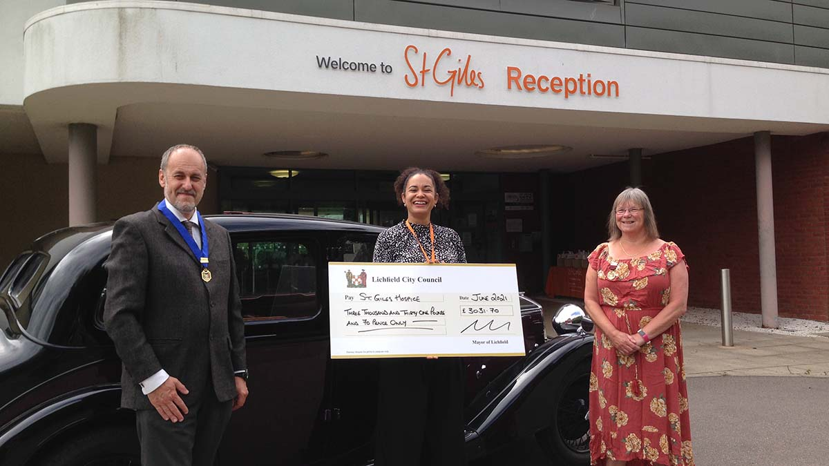Dr Daryl Brown and Cllr Deborah Baker handing over a cheque at St Giles Hospice