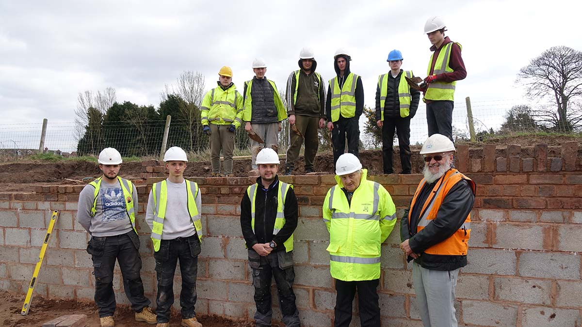 Noel Sweeney (front, second right) on a visit to Lichfield and Hatherton Canals Restoration Trust's site to meet college students he helped to get work experience