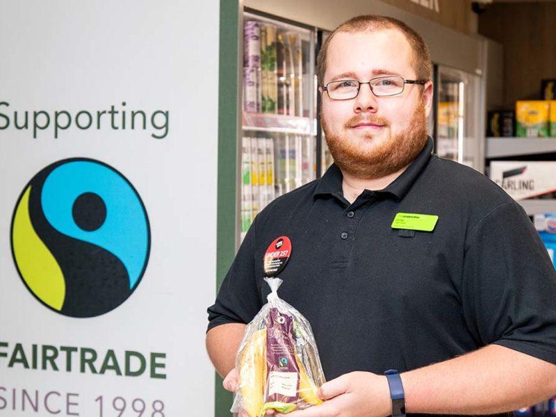 Co-op staff member with Fairtrade bananas