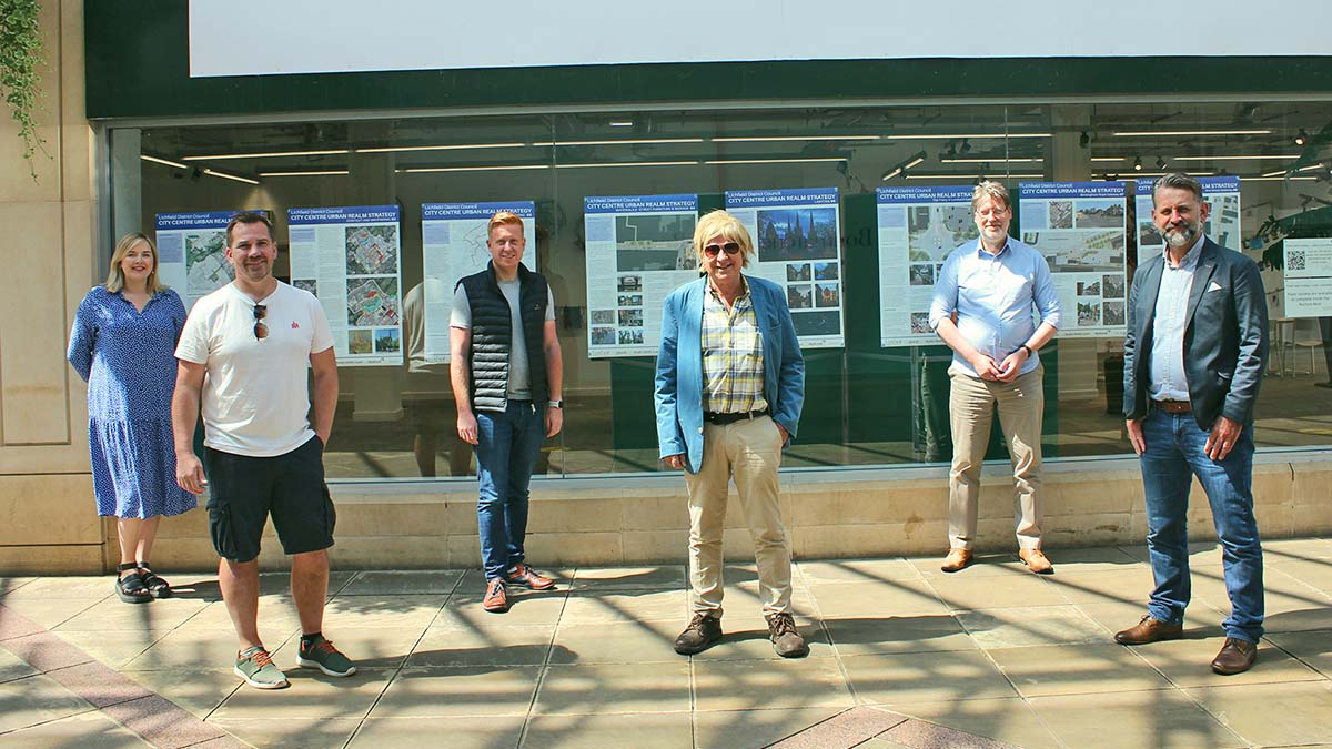 Michael Fabricant joins council representatives outside the exhibition of plans for the future of the city centre