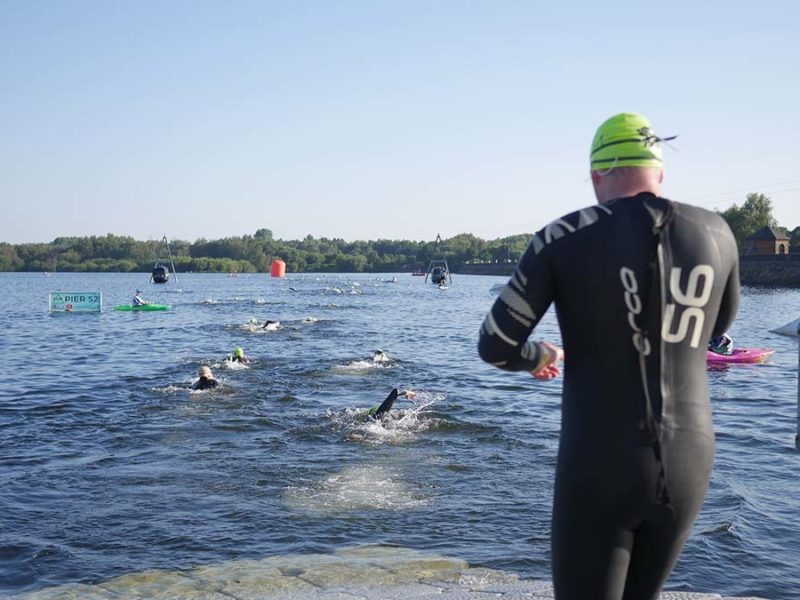 Competitors heading into the water for the swim at Chasewater
