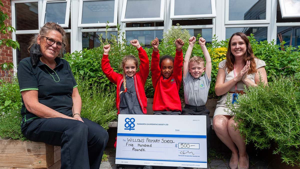 Nicky Gilbert with deputy headteacher Laura Lazenby and some of the pupils in the herb section of the school's garden