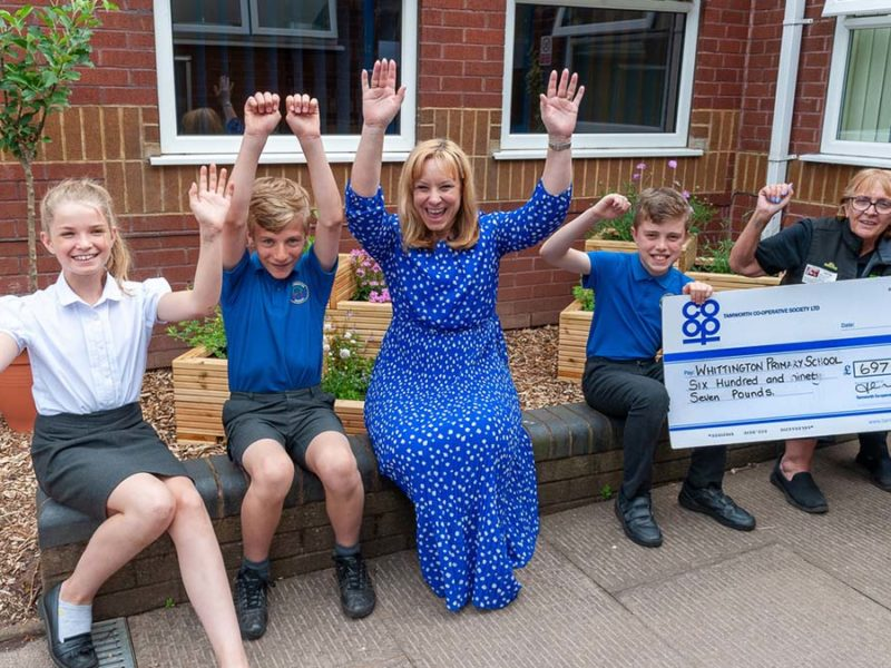 Headteacher Nichola Leeson and Co-op store manager Sheila Villers with pupils at Whittington Primary School