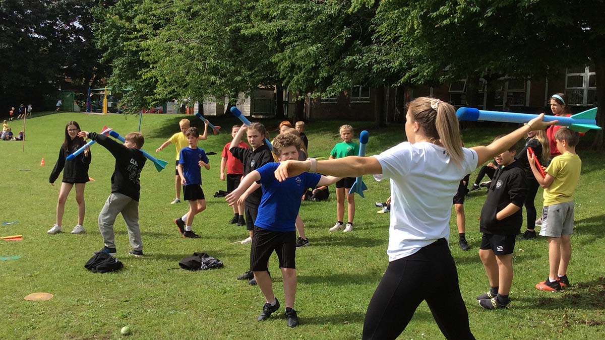 Katie Stainton teaching javelin skills