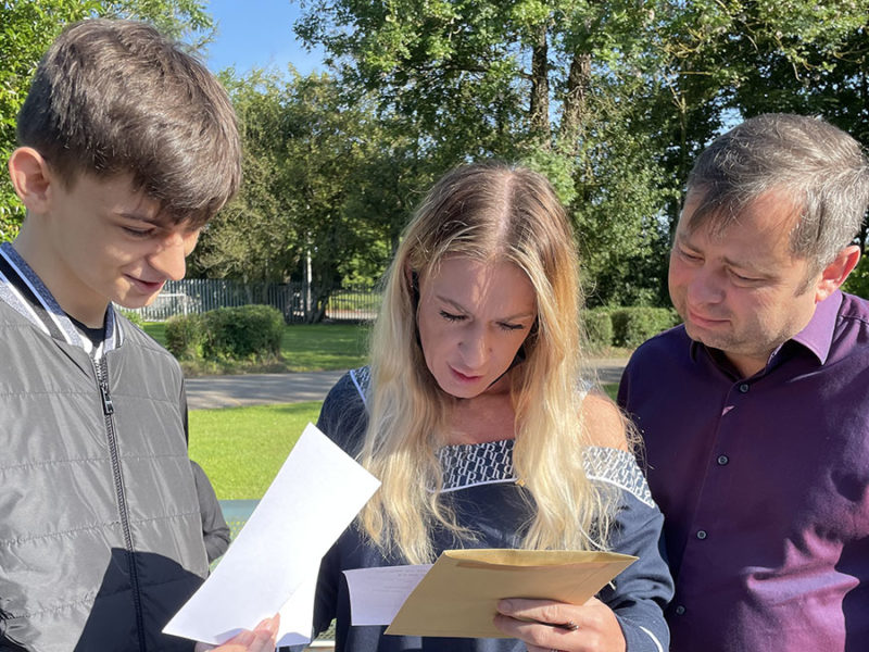 Christian Carr receiving his GCSE results with parents Karl and Gayle