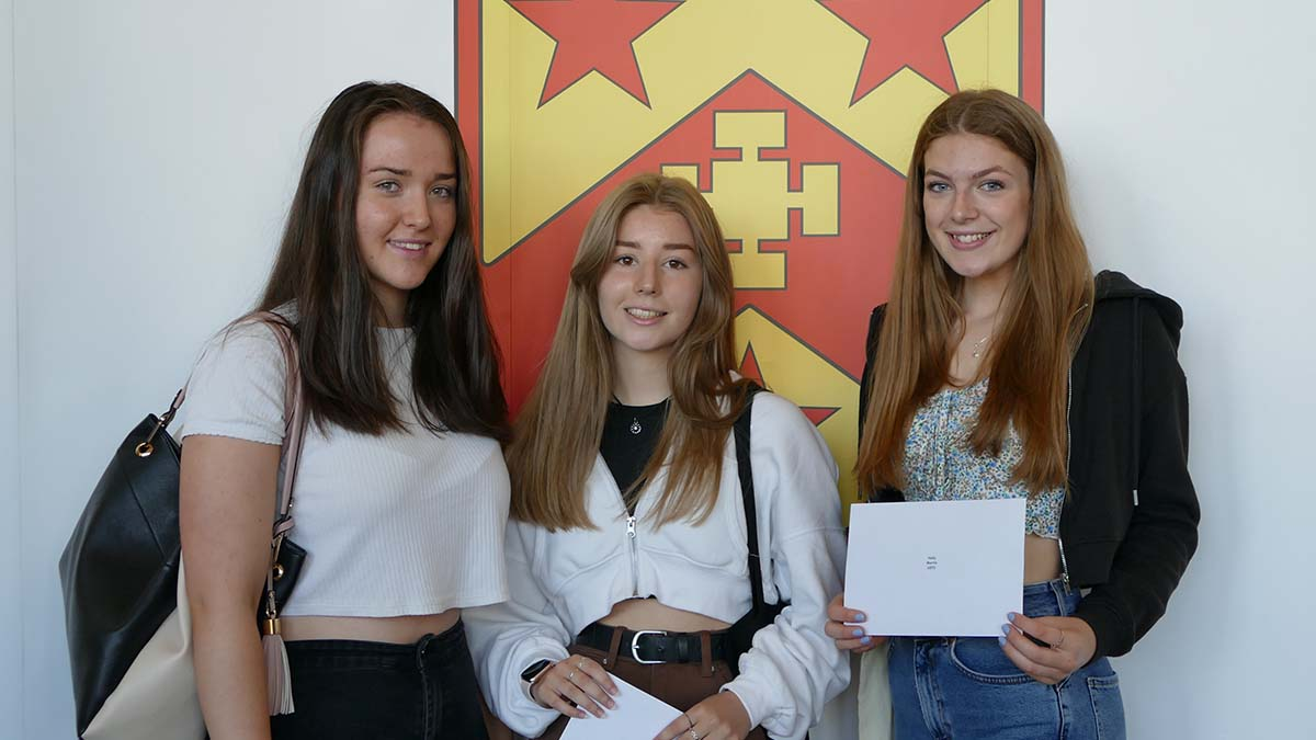 Sophie Forbes, Ellie Sanders and Lowri Simmons collecting their GCSE results