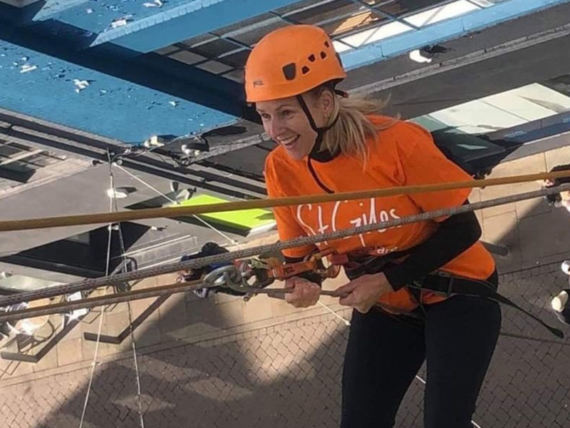 Claire Barton taking on the St Giles Hospice abseil challenge in 2019