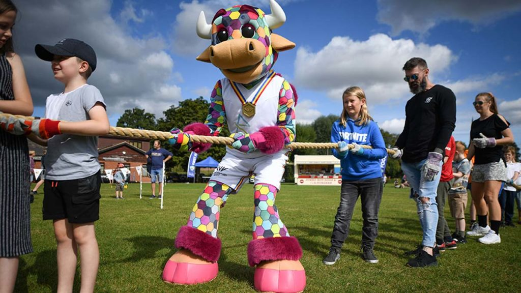 Perry the Commonwealth Games mascot taking part in tug of war