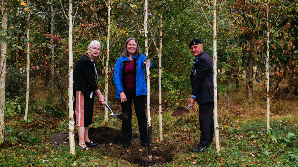 The final tree being planted by Una Cleminson, Jacqui Thompson and Terry Barnett
