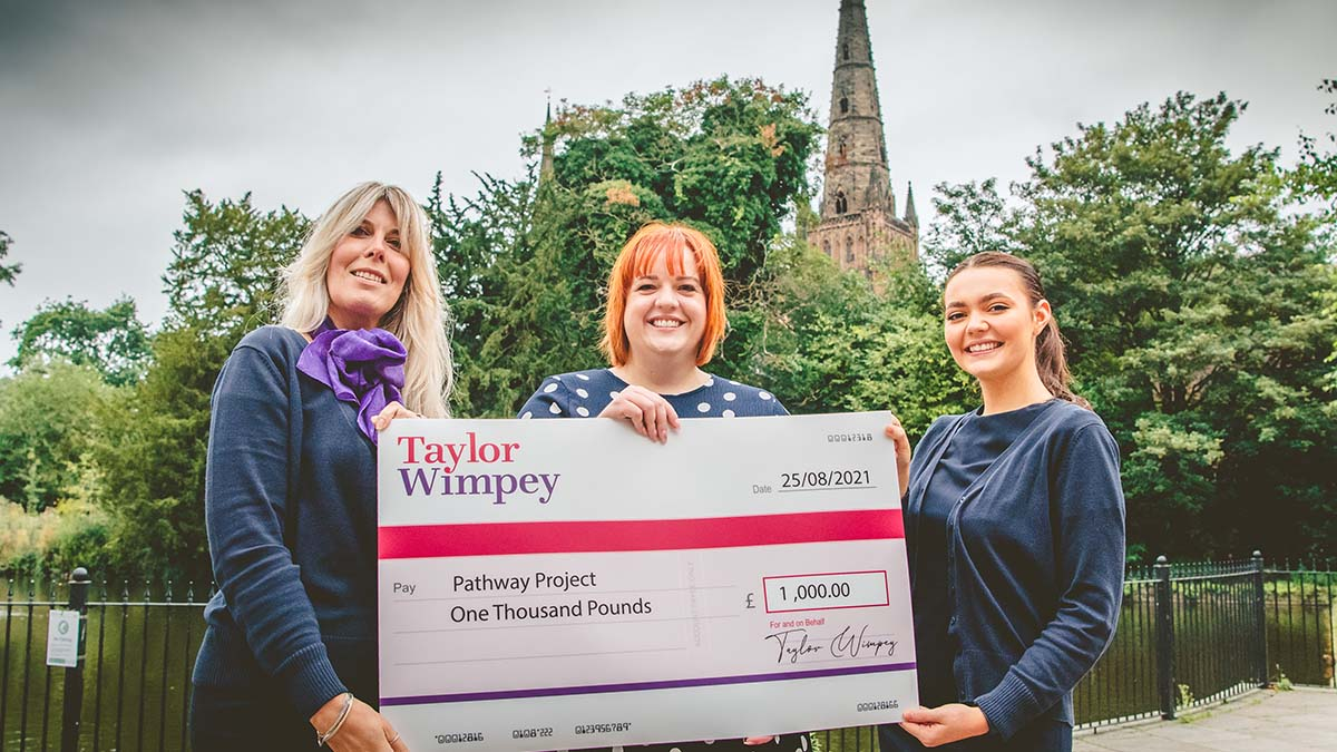 The funding cheque being handed over to Pathway Project