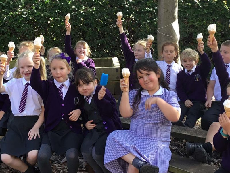 Year 2 pupils enjoying their celebratory ice creams