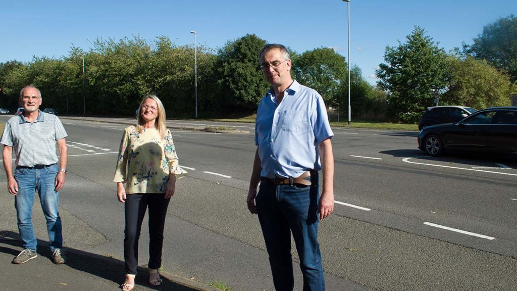 Residents Robin Horton and Elaine Hutchings who have been campaigning for safety improvements at the junction alongside Cllr Paul Ray