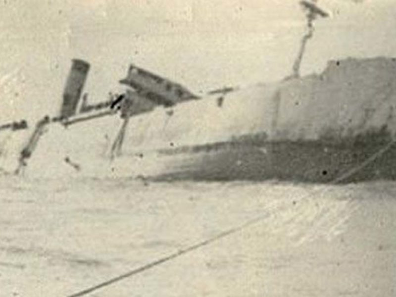 The only known photo of the Lisbon Maru going down after being torpedoed