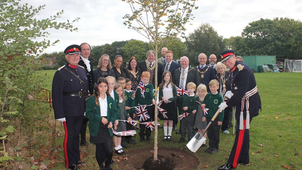 The tree-planting ceremony at Charnwood Primary School