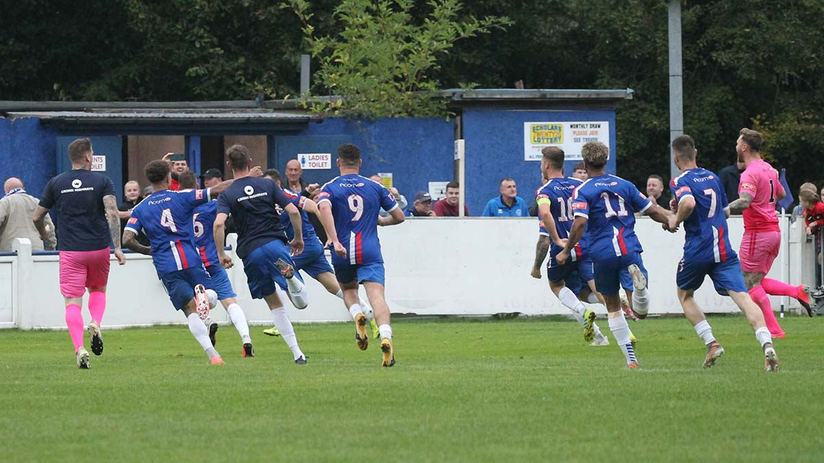 Chasetown's players celebrate their win against Halesowen Town. Picture: Dave Birt